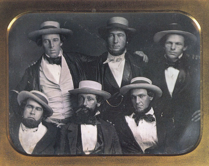 "Baseball history photo: A photo purported to be of the New York Knickerbockers Baseball Club circa 1847. The only positively identified member of the Knickerbockers Base Ball Club in this photo is Alexander Cartwright (top center). Harold Peterson, author of ""The Man Who Invented Baseball"", has conjectured that the clean-shaven fellow at the top left may be Cartwright's younger brother, Alfred. Indeed, the two young men are similar in appearance and each has his arm around the other's shoulder. (According to club records, Alfred was never a member of the Knickerbocker Base Ball Club.) Some have proposed that the individual at lower left is Duncan Curry, first Knickerbocker club president. This identification is based solely on a photo of a much older Curry on p. 54 of Albert Spalding's ""America's National Game."" This identification is tenuous at best. The cigar-smoking chap at lower center bears some resemblance to Daniel ""Doc"" Adams, though the conjecture is by no means definitive. In short, though it is not unlikely that this image is of six members of the Knickerbockers, it is by no means definitively a Knickerbocker team photo.  Click photo to return to previous page."